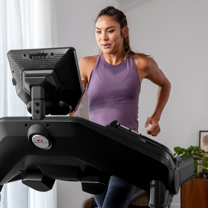 A woman running on a treadmill 10. - expanded view