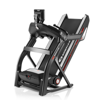 Treadmill 10 in folded position.--thumbnail