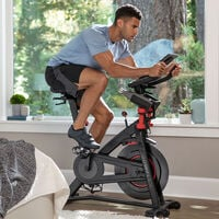 Man riding a stationary Bowflex C6 exercise bike--thumbnail