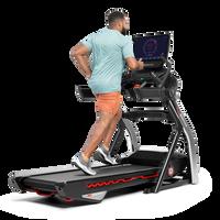 Man using the touchscreen on the Treadmill 22--thumbnail