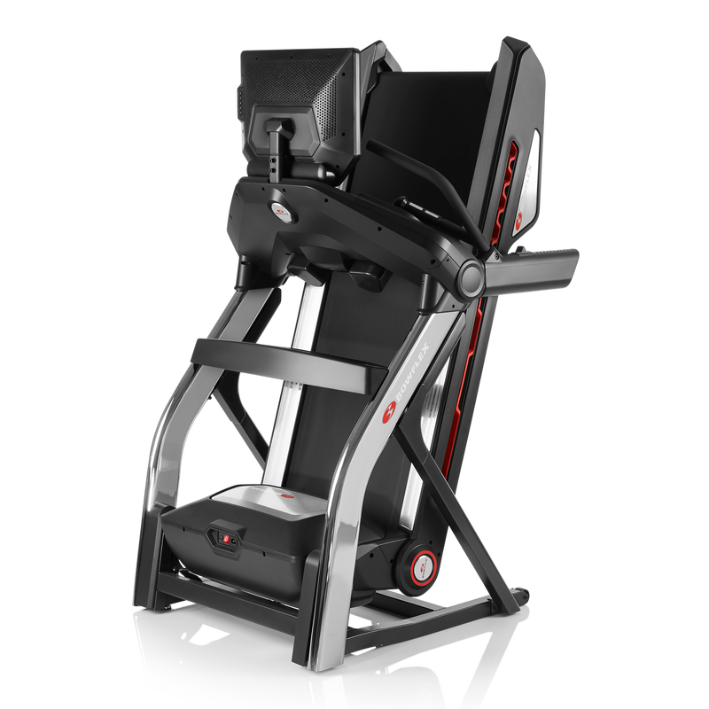 Treadmill 22 shown in folded storage position - expanded view