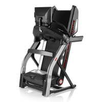 Treadmill 22 shown in folded storage position--thumbnail