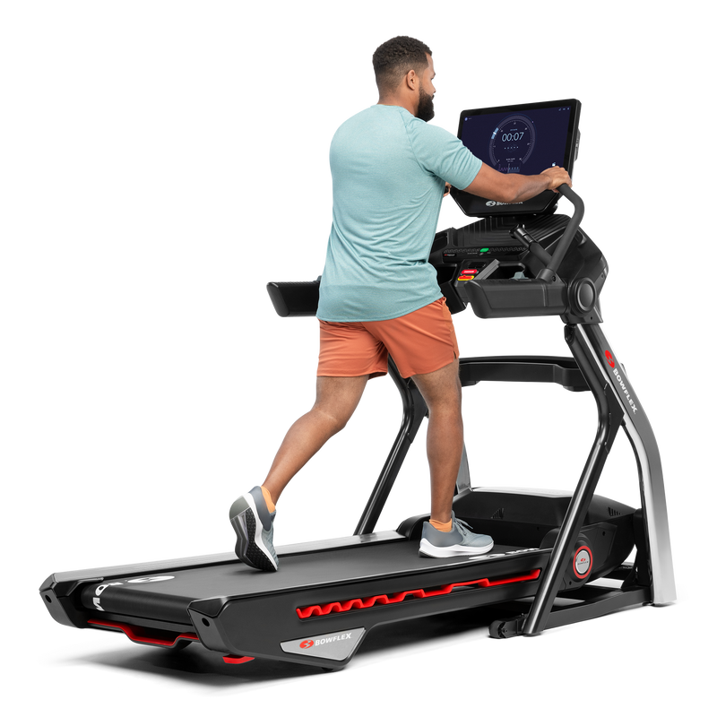 Man using the extended handlebars on the Treadmill 22 - expanded view