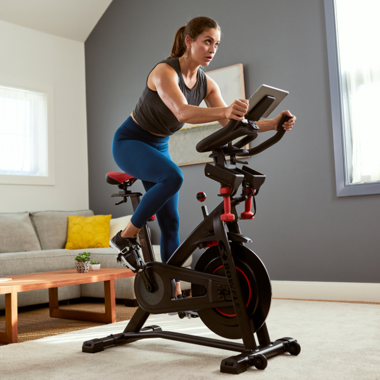 A woman working out on a C6 Indoor Cycling Bike.