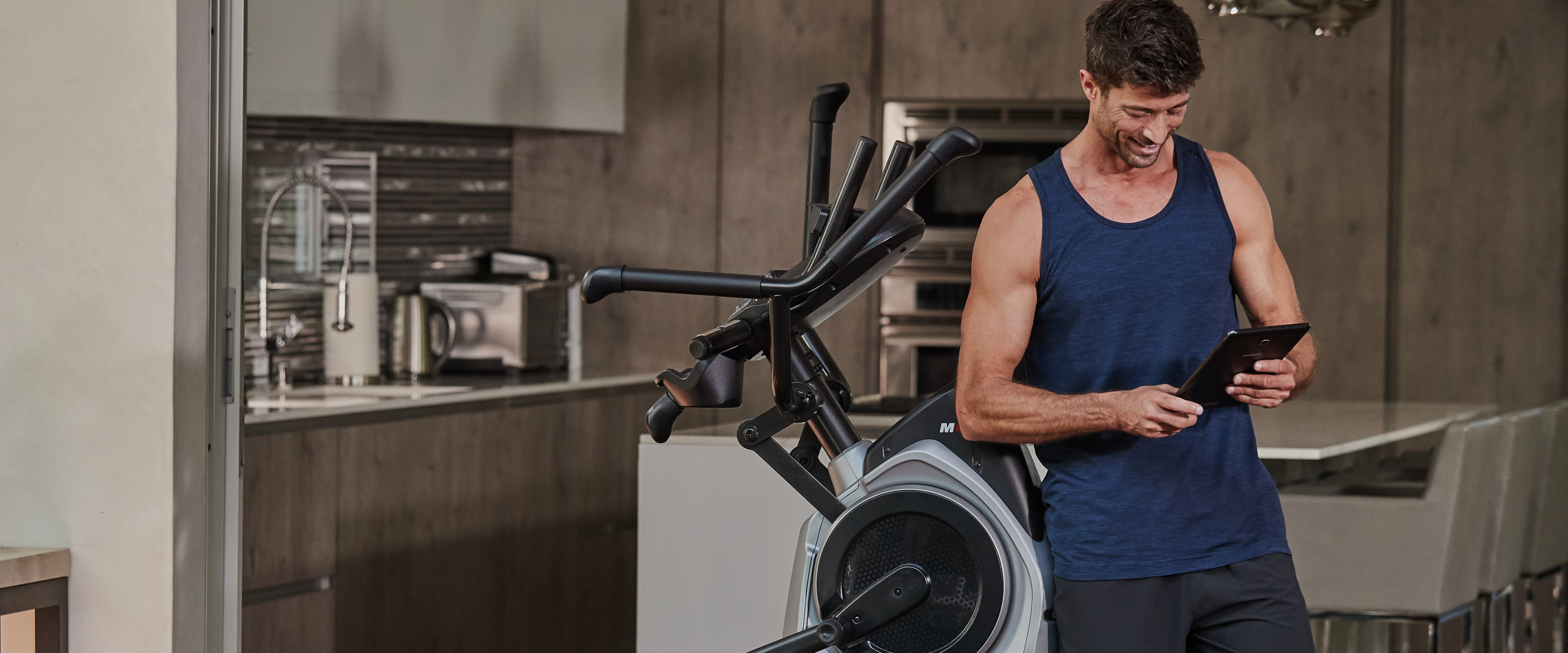 Man using a Bowflex Max Trainer M6