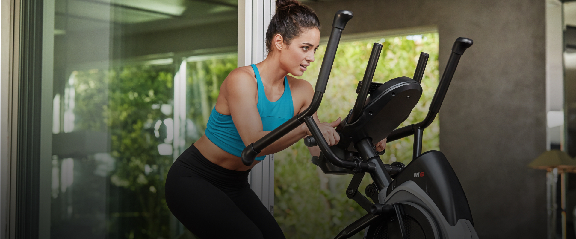 woman walking on a Max Trainer cardio machine