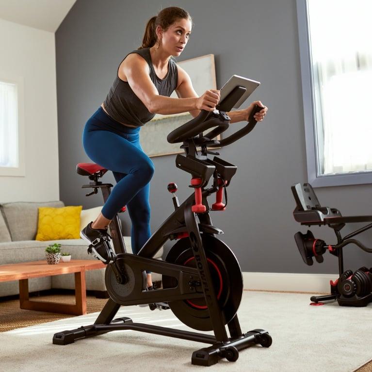 A woman using a Bowflex C6 Bike