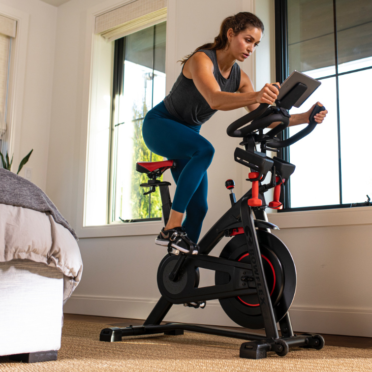 exercise bike conveniently placed in a bedroom