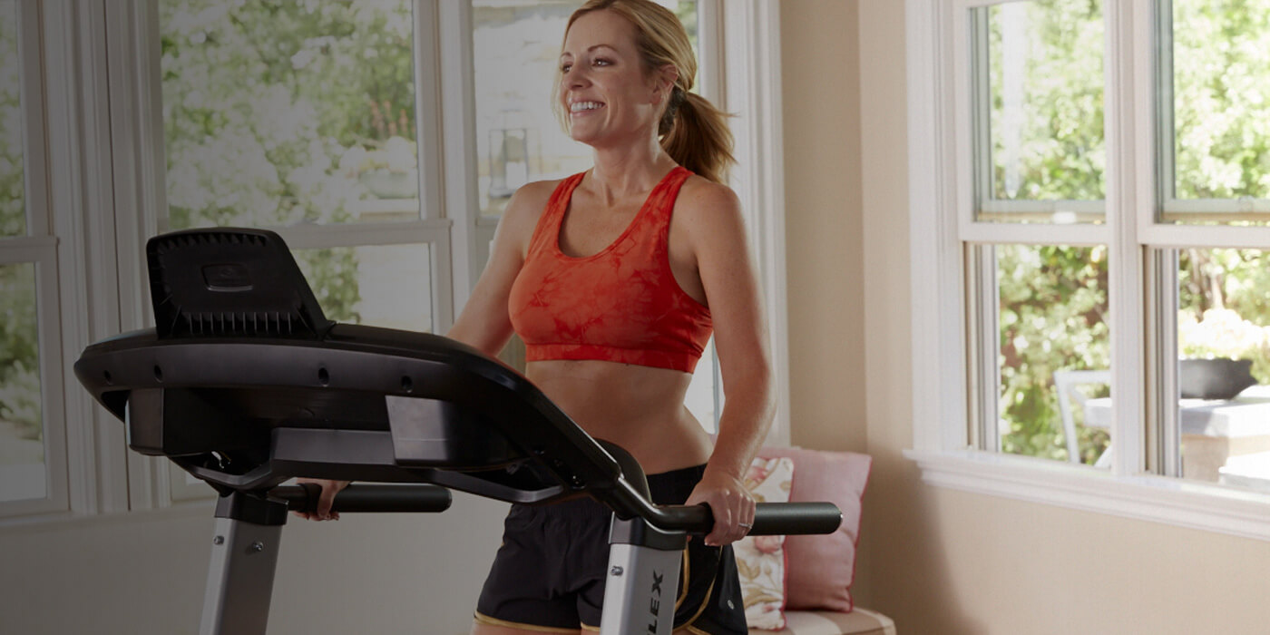 Shelly exercising on a TreadClimber