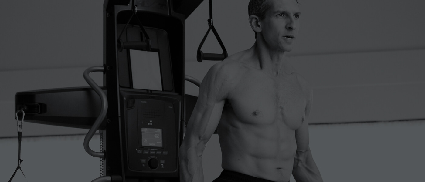 Todd exercising with Bowflex HVT