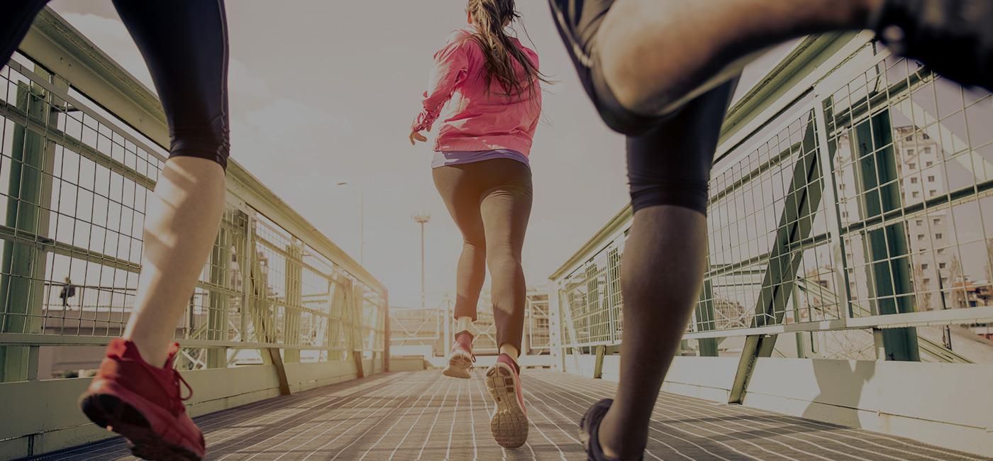 three women running outside
