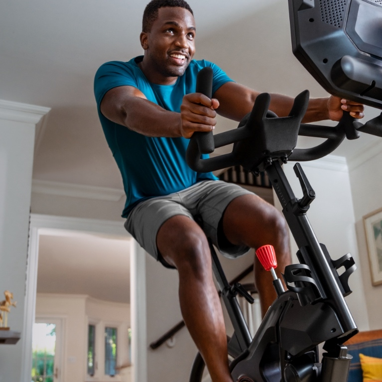 A man riding a Bowflex VeloCore bike.