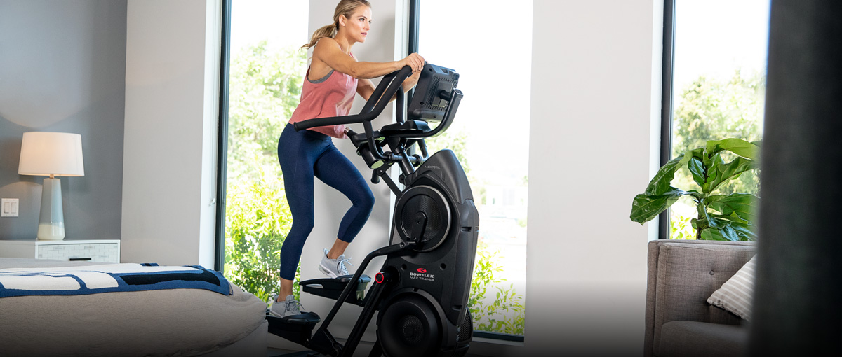 Woman working out on a Max Trainer in her bedroom