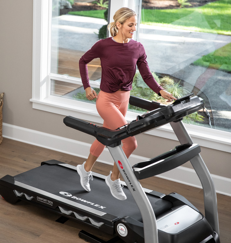 Woman using a Bowflex Treadmill